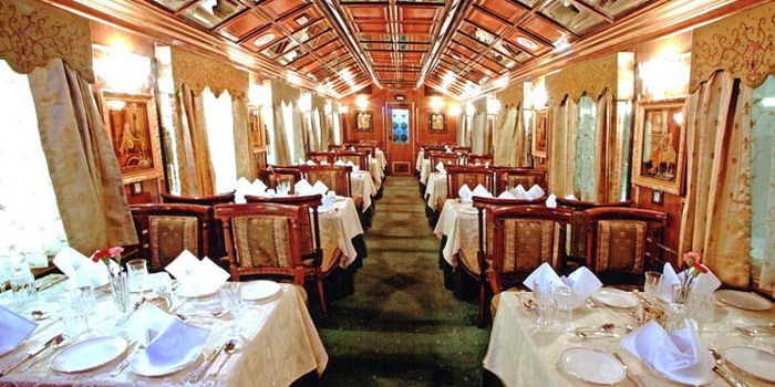 Palace on Wheels - 'A Royal Experience.' Luxury tourist train. It was launched by the Indian Railways to promote tourism in Rajasthan, and has been highly popular since its launch. Palace on Wheels comprises 14 deluxe air-conditioned saloons, completely self-sufficient and tastefully equipped to impress modern travellers. Each compartment is equipped with hot and cold water, attached toilet, shower, intercom, wall-to-wall carpeting and soothing channel music while the passengers enjoy their well-deserved sleep.