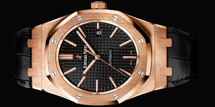 Audemars Piguet Royal Oak Selfwinding watch with date display and centre seconds. 18-carat pink gold case, silvered dial, black strap.