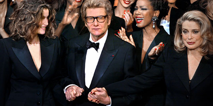 Yves Saint Laurent (1936-2008) at fashion show (January 2002) with friend and muse Catherine Deneuve, and models.