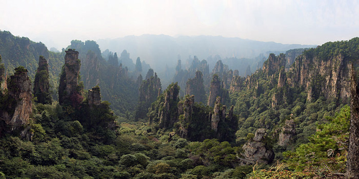 Zhangjiajie National Forest Park, China. It became internationally renown since the release of the 2009 movie Avatar. The movie was filmed in these mountains, more specifically, the Hallelujah Mountain (of Avatar) was filmed there and the movie's editing team simply added the mountains in post-production to make them look like they are floating in the air.