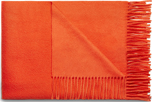 Acne Studios Canada Celosia Orange is a fringed women's scarf made in warm, super soft cashmere: US$440.