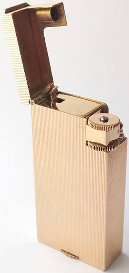 Boucheron lighter, 18 kt gold, boxed.