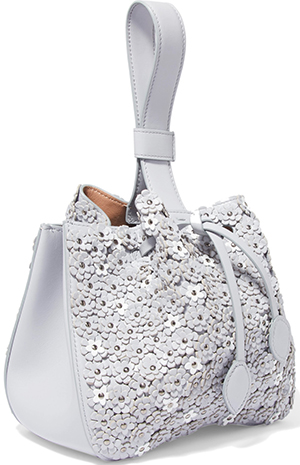 Alaïa Laser-cut appliquéd leather wristlet bag: US$4,280.