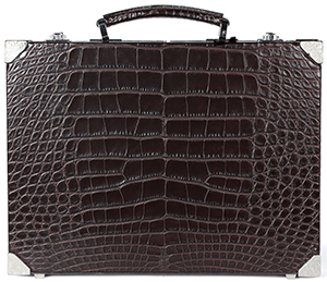 Brioni Ultra-thin Hard Case in crocodile with metal details and inner lining in grosgrain: €22,000.