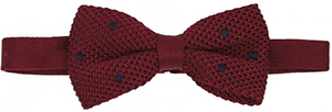 Claret knitted silk bow tie with navy-blue dots: €65.