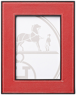 Hermès leather picture frame in vermillion red goatskin with solid rosewood: US$930.