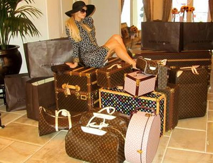 Paris Hilton with her Louis Vuitton luggage.