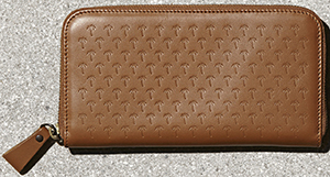 Tomas Maier women's zip around wallet: US$445.