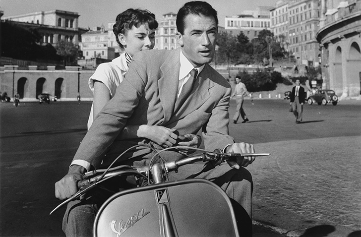 Joe (Gregory Peck) and Ann (Audrey Hepburn) on a scooter ride through Rome in the film 'Roman Holiday' (1953).